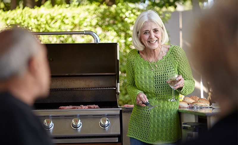Woman Barbecuing at The Cottages of Petaluma